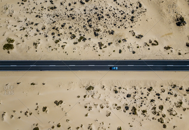 Car driving on road in picturesque desert