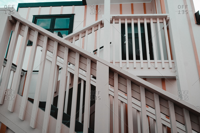 From below wooden stairs of cottage in west neighborhood