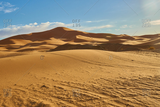 Desert with sand hills and blue heaven with sunshine in Marrakesh, Morocco