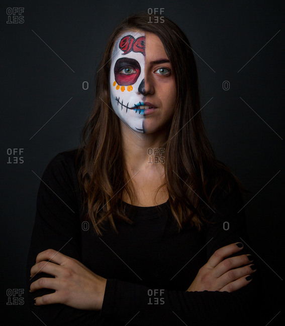 Young woman with creepy face paint