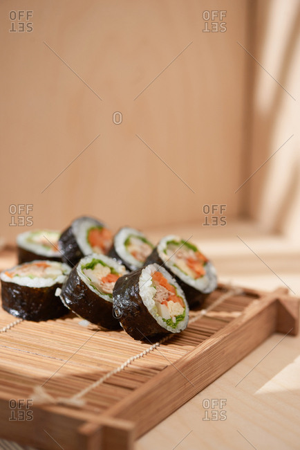 Korean roll Gimbap (kimbap) made from steamed white rice (bap) and various other ingredients
