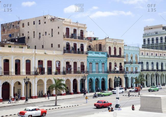 March 6, 2019: Cuba, Havana, broken old car, friends pushing, downtown havana Y 03/09/2019