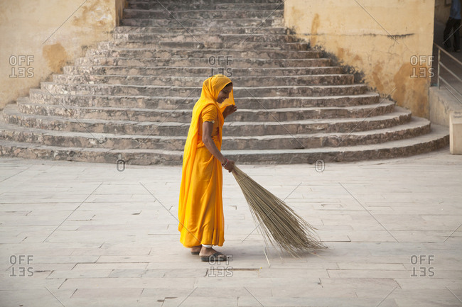 October 24, 2011: India, Jaipur, Amber fort,  cleaing lady early morning sweepingt before tourist arrive . Y 10/24/2011