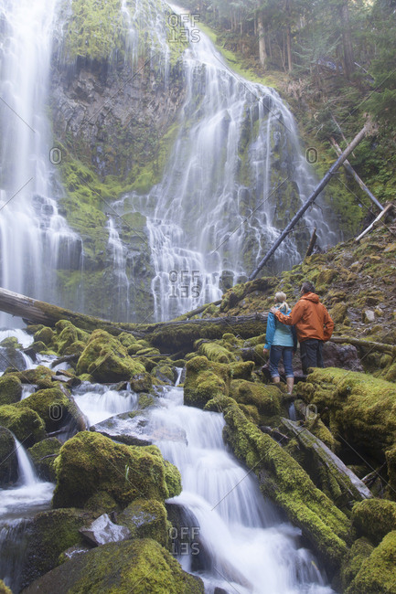 September 23, 2011: USA, Oregon state, Lower Proxy falls, young couple hiking near falls.