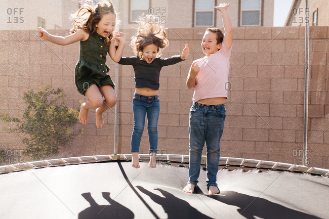 Children jump on trampoline