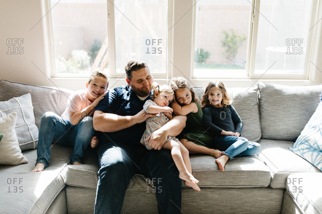 Dad with his kids on the couch