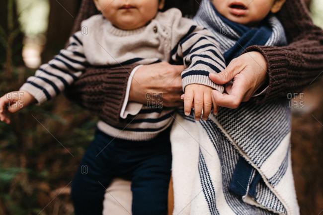 Grandma holds grandchildren