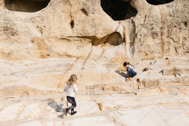 Little girls hiking on rock face in Mt. Diablo, California