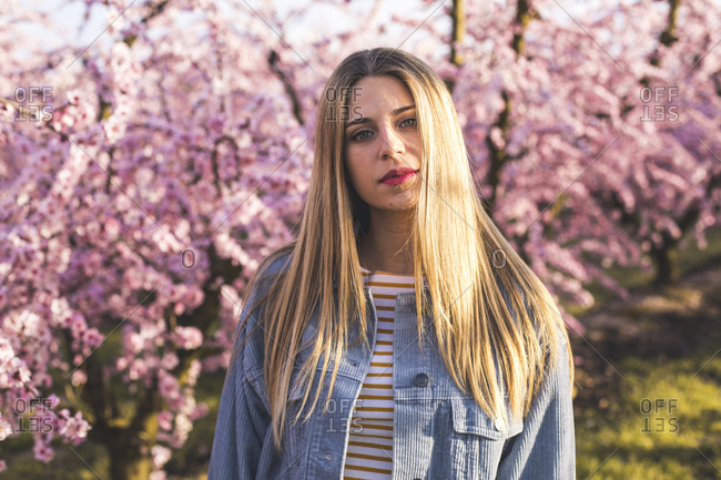 Portrait of a woman in a field of peach trees in Aitona, Lleida