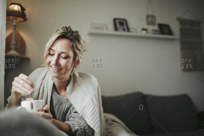 Woman with teacup on the couch