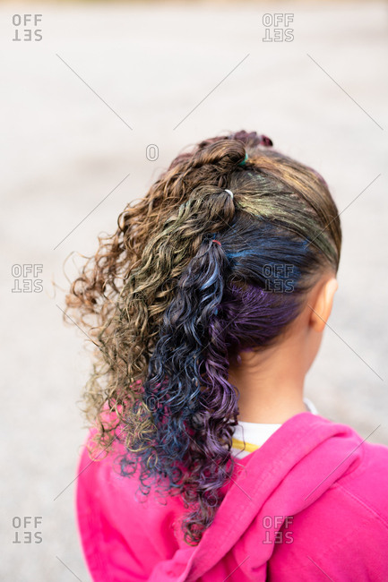 Young girl with rainbow hairstyle from behind