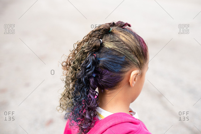 Little girl with rainbow hairstyle