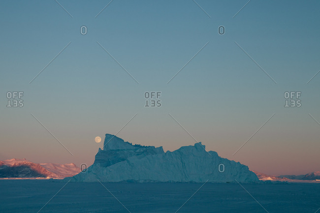 Moon over icebergs in Greenland