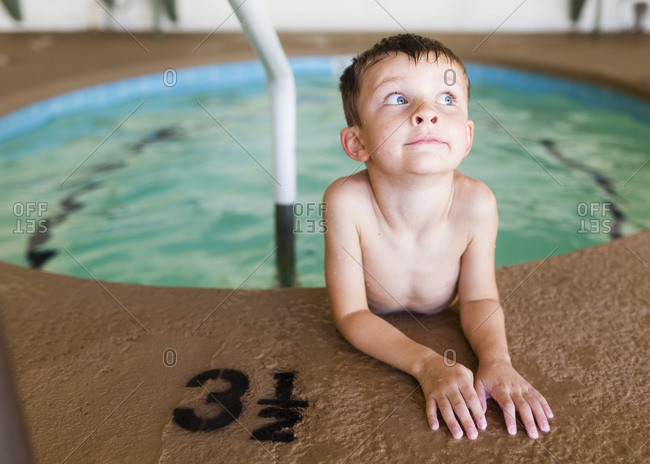 Boy sits in the pool