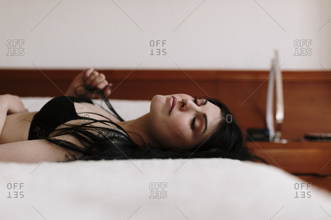 Woman lies on bed