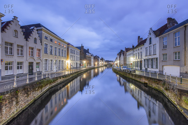 December 2, 2016: Belgium- Bruges- row of houses at canal by twilight