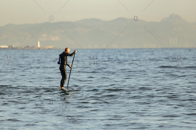 Spain- Andalusia- Tarifa- man stand up paddle boarding on the sea