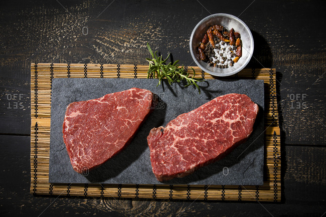 Raw beefsteaks and spices - Offset