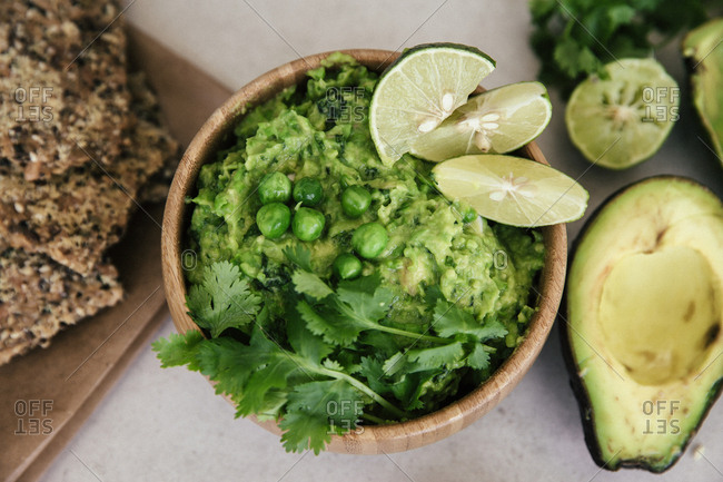 Guacomole with peas- avocado- lime- coriander and crisp bread