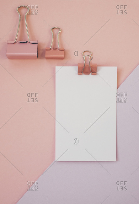 Blank paper against pink and purple background
