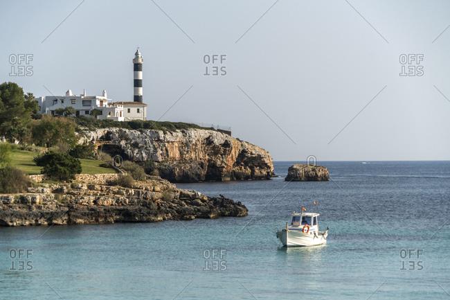 Spain- Baleares- Mallorca- Portocolom- Lighthoue and fishing boat
