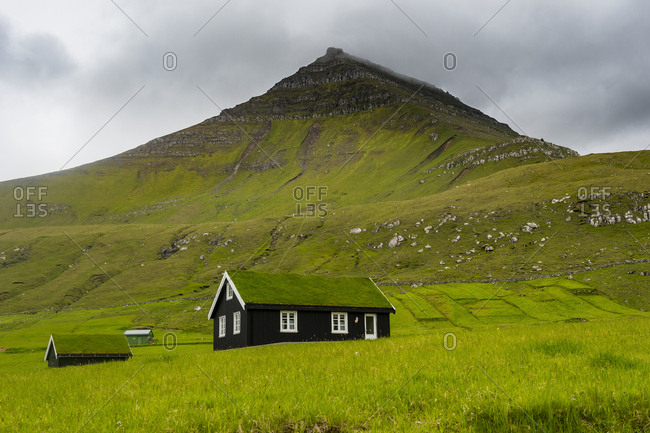 Denmark- Faroe islands- Estuyroy- Lonely grass roofed house in Gjogv