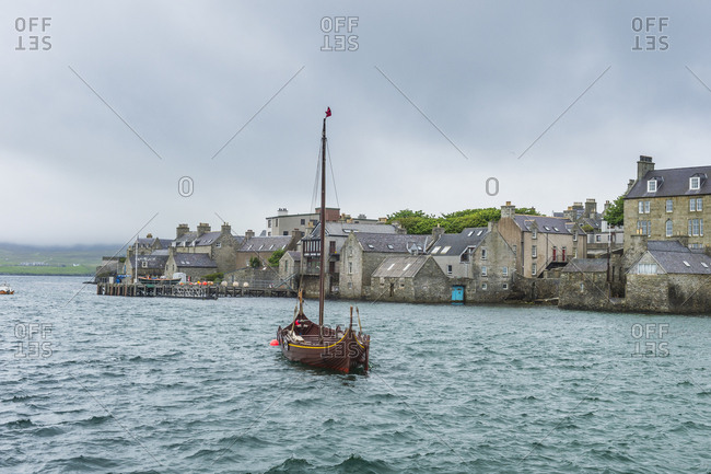 United Kingdom- Scotland- Shetland Islands- Mainland- Old viking boat before the seafront of Lerwick