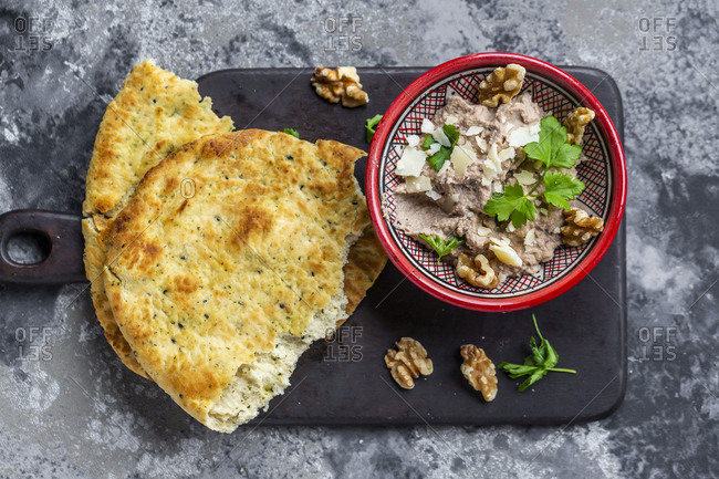 Bowl of homemade aubergine cream with walnuts- parmesan and parsley served with pita bread