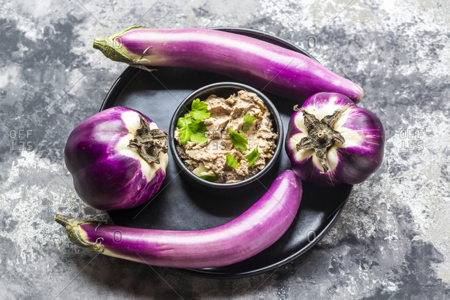 Bowl of homemade aubergine cream with walnuts- parmesan and parsley served