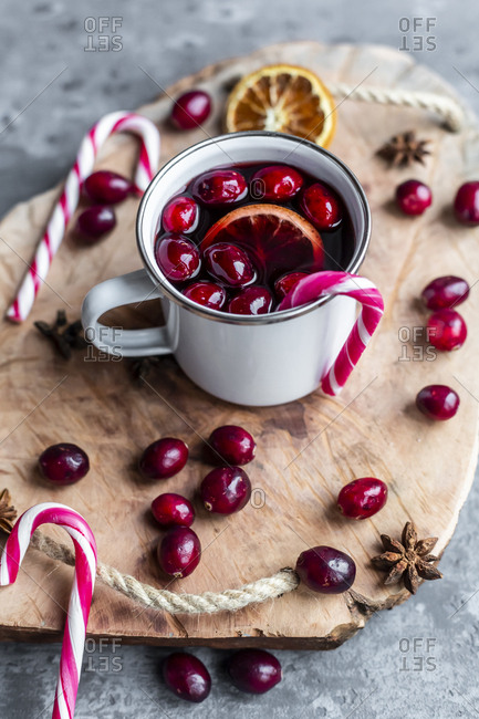 Mug of Mulled Wine with cranberries- orange slice- star anise and candy cane