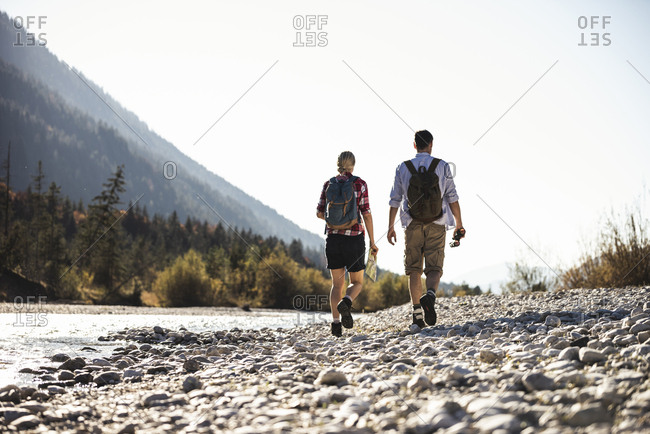 Austria- Alps- couple on a hiking trip with map and binoculars