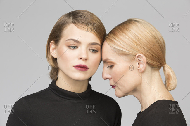 Studio portrait of mother and adult daughter
