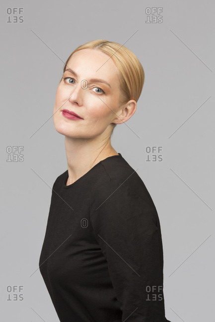 Studio portrait of confident mature woman