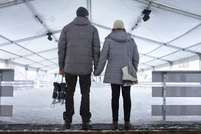 Couple standing at the ice rink