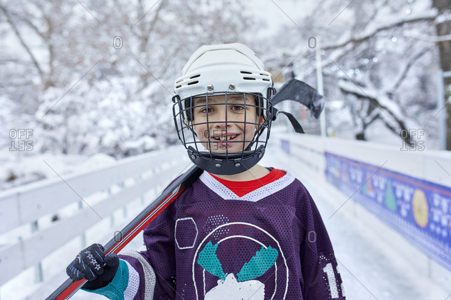 Portrait of a boy in ice hockey gear