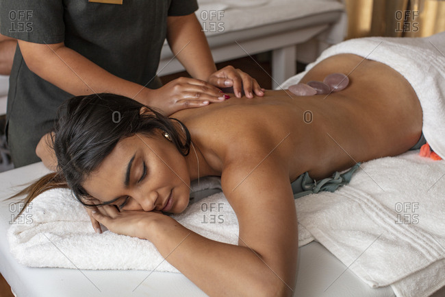 Woman receiving a massage in a spa