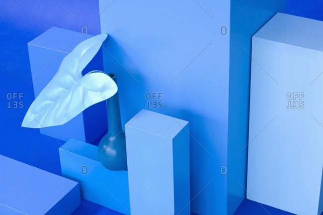 Various cuboids- blue vase with blue leave