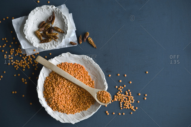 Red lentils and chili pods in bowls