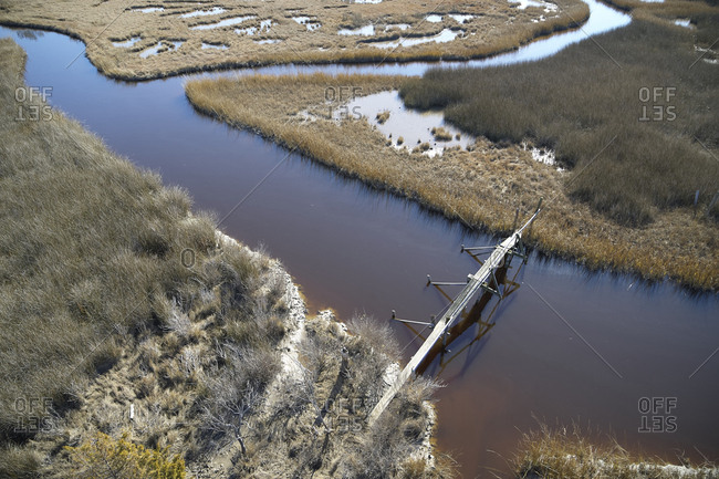 USA- Marsh on the eastern shore of Maryland with a walking path and pedestrian bridge- sea level rise due to global warming
