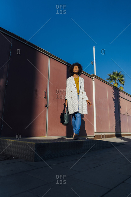 Beautiful woman standing in front of wall in the city