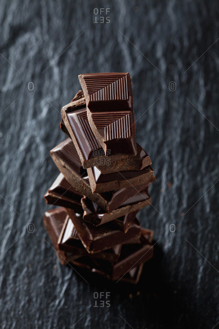 Pile of chocolate pieces on black slate