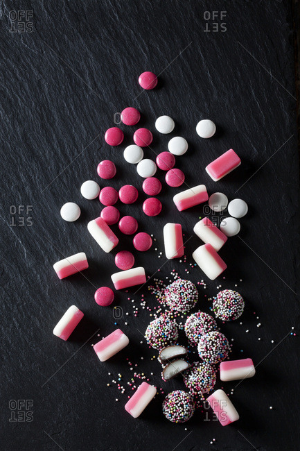 Various pink and white candies- peppermint candy- choclate buttons- fondant balls