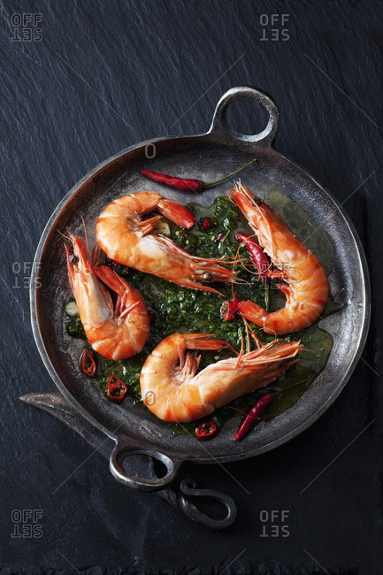 Prawns with hernbs- chili and garlic in iron pan