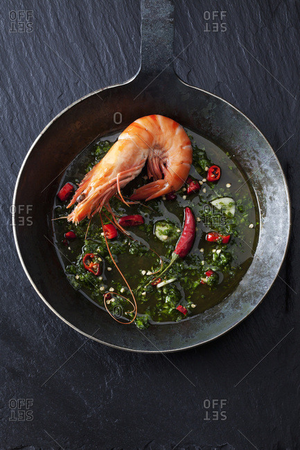 Prawn with hernbs- chili and garlic in iron pan