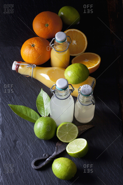 Freshly squeezed lime and orange juice in a swing top bottles