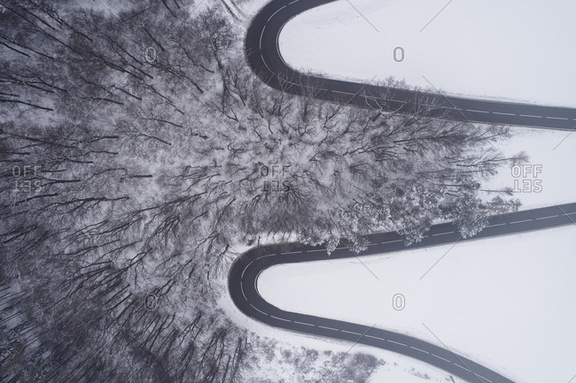 Austria- Wienerwald- winding road in snow-covered landscape- aerial view