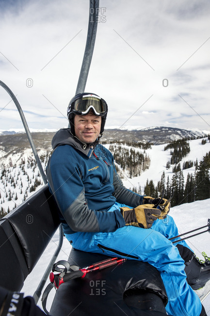 March 15, 2013: USA, Colorado, Aspen, skier rides on the Ruthie's ski lift, Aspen Ski Resort, Ajax Mountain