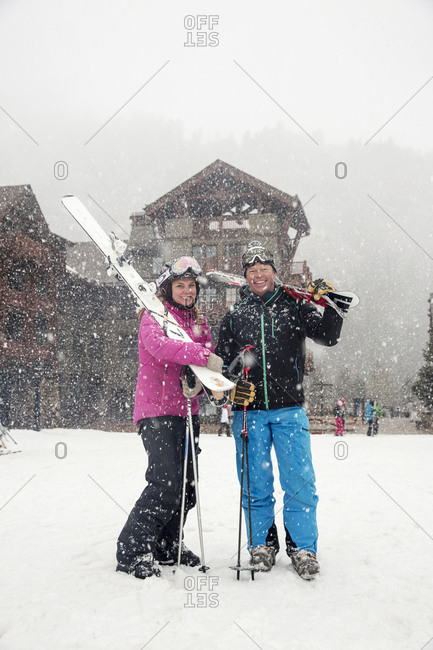 March 16, 2013: USA, Colorado, Aspen, portrait of skiers at the Highlands Mountain base n the falling snow, Highlands Ski Resort