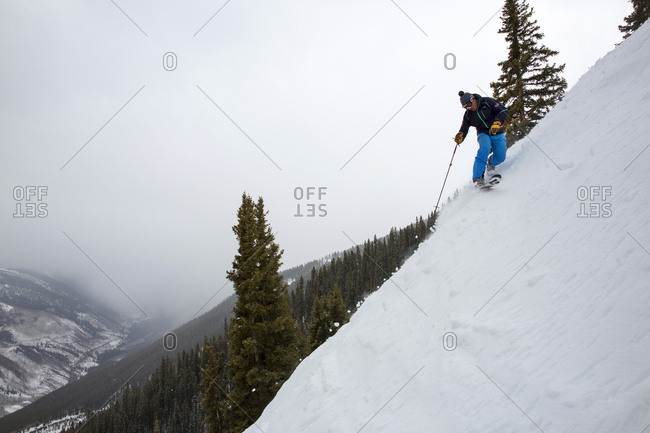 March 16, 2013: USA, Colorado, Aspen, telemark skier makes turns on Kessler's run, Aspen Highlands Ski Resort