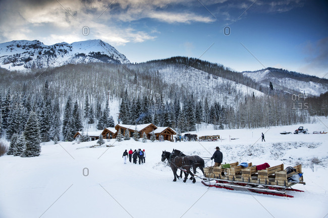 March 16, 2013: USA, Colorado, Aspen, following a sleigh ride dinner guests are dropped off at the Pine Creek Cookhouse in the Elk Mountains